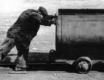 Euroarce History Man pushing a car